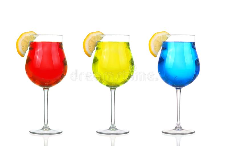 Set of beautiful shot glasses filled with colored alcoholic cocktails.  stock photos