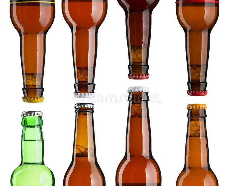 Set of beer bottle necks with caps royalty free stock photos