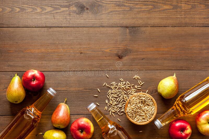 Set of beer bottles with apple, pears, wheat from above royalty free stock image