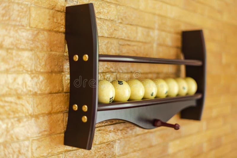 Set of billiard balls for pool game or American billiards on shelves. Russian pool billiard. Pool billiard game. Billiard sport co royalty free stock photography