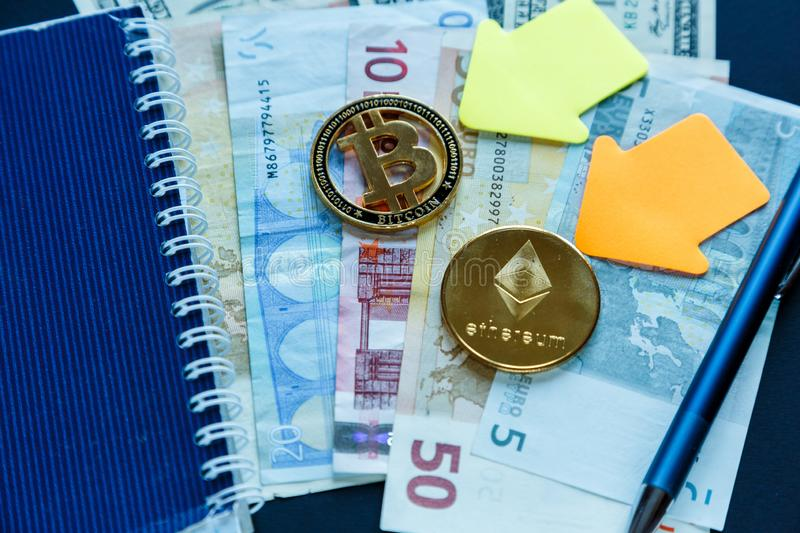 Set of bitcoin, ethereum - crypto currency next to notepad on real money background. Time is money. Internet e-commerce, security royalty free stock photo