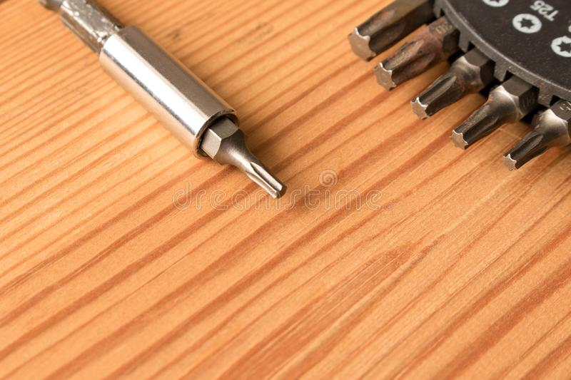 Set of bits on wooden table. The concept of the work. Labor day.  royalty free stock photos