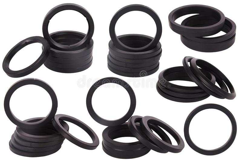 Set of black gaskets isolated. Oil seals for hydraulic cylinders for Industrial on white background. royalty free stock photo