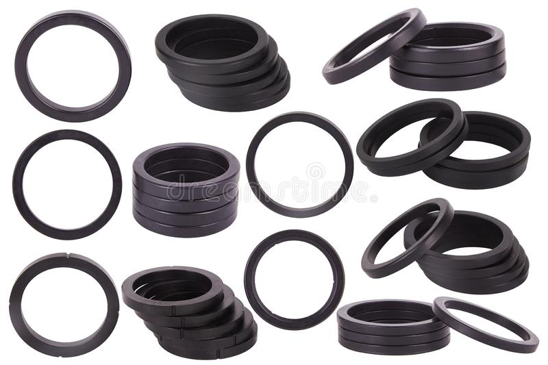 Set of black gaskets isolated. Oil seals for hydraulic cylinders for Industrial on white background. Rubber rings. Sealing gaskets for hydraulic joints. Rubber royalty free stock photography