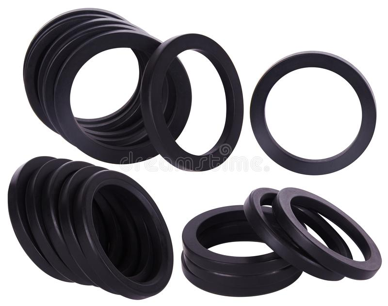 Set of black gaskets isolated. Oil seals for hydraulic cylinders for Industrial on white background. Rubber rings. Sealing gaskets for hydraulic joints. Rubber royalty free stock photo