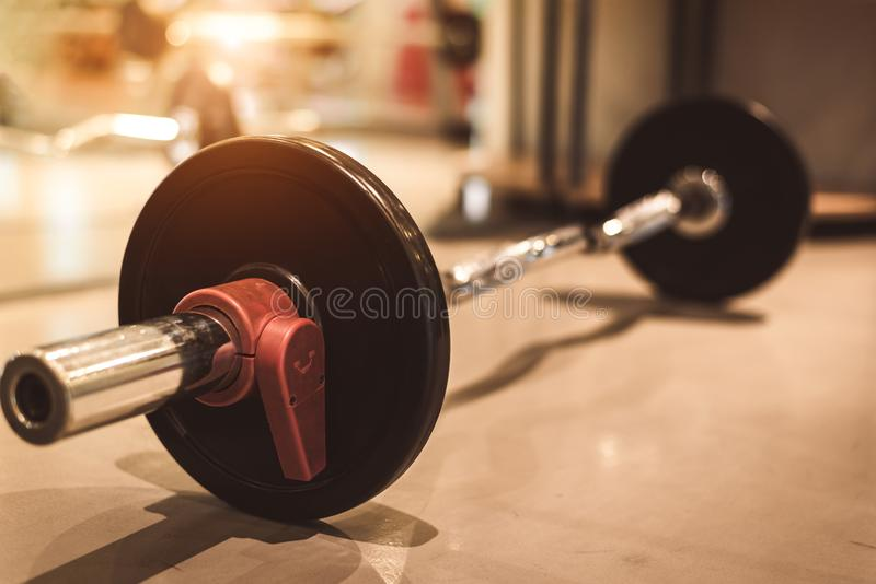 Set of black heavy steel barbells on fitness sport gym floor. Object and exercise concept. Workout training and bodybuilder. Sport royalty free stock image