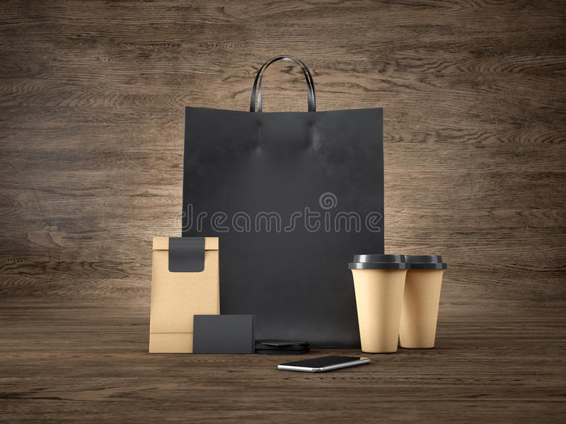 Set of black shopping bag, craft package, two brown coffee cups, blank business cards and generic design smartphone stock illustration