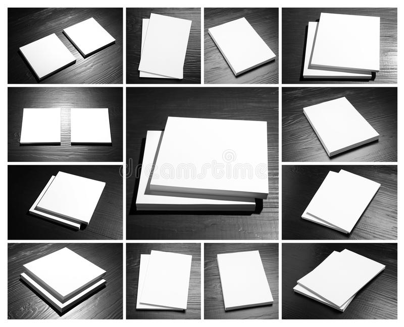 Set of blank brochures on black wooden table. Mock up for design royalty free stock image