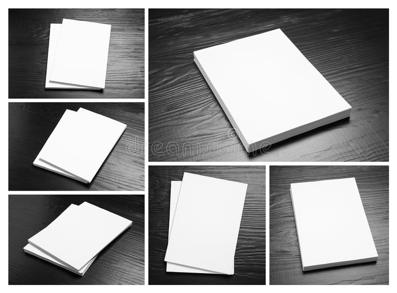 Set of blank brochures on  wooden table. Mock up for design. Set of blank brochures on black wooden table. Mock up for design royalty free stock photo