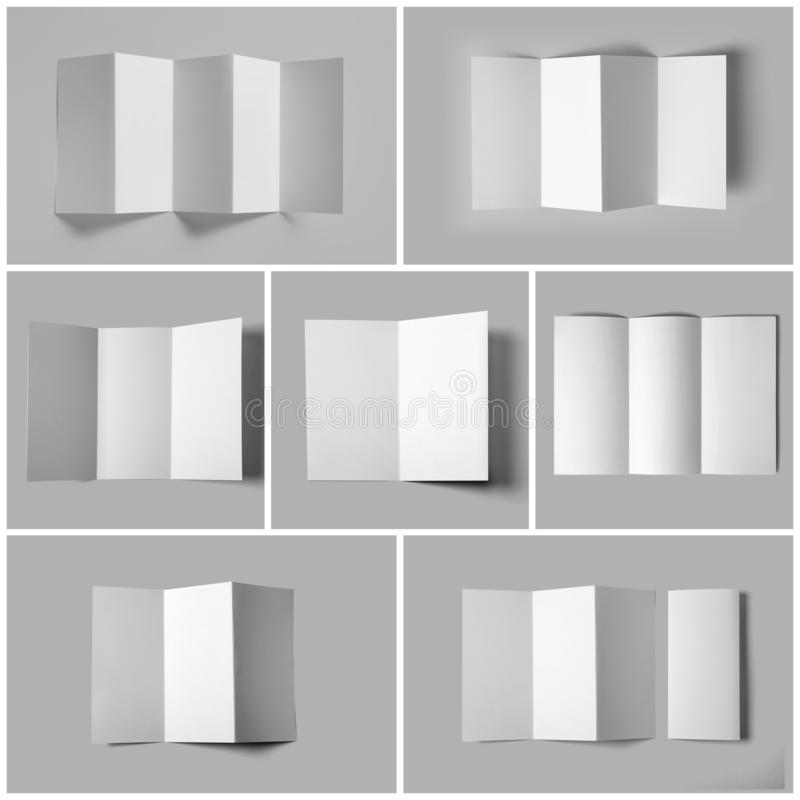 Set of blank brochures on light grey background, top view. Mock up for. Design stock photos