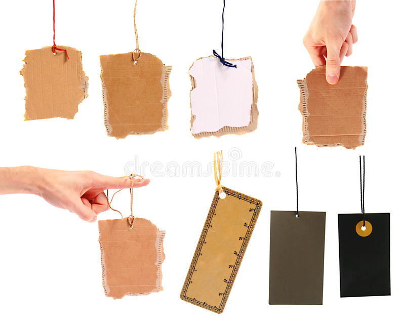 Set of blank cardboard tags. Hanging on white background stock images