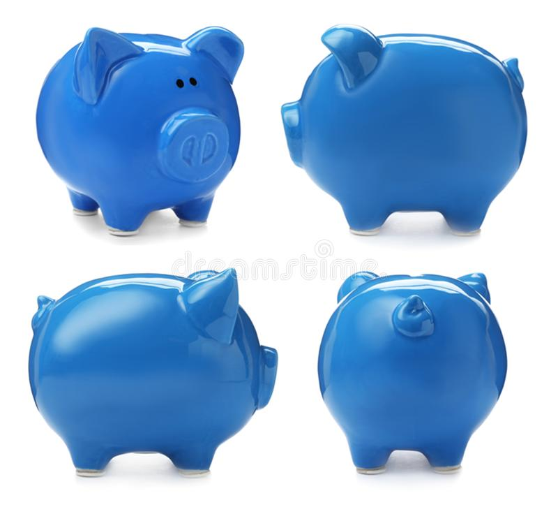 Set with blue piggy bank from different views. On white background royalty free stock photography