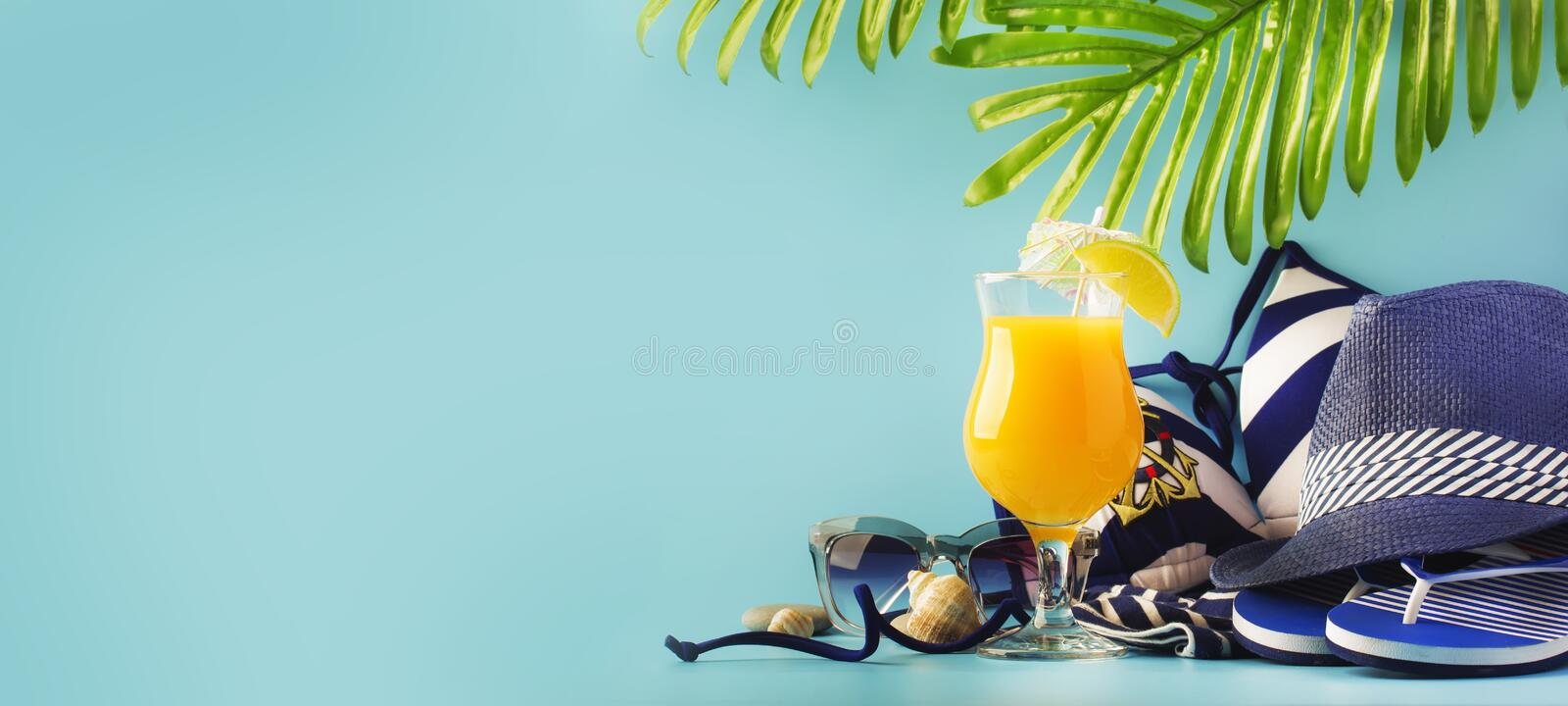 Set of blue white summer beach things in nautical style for vacation with orange cocktail on blue long background, space for text stock images