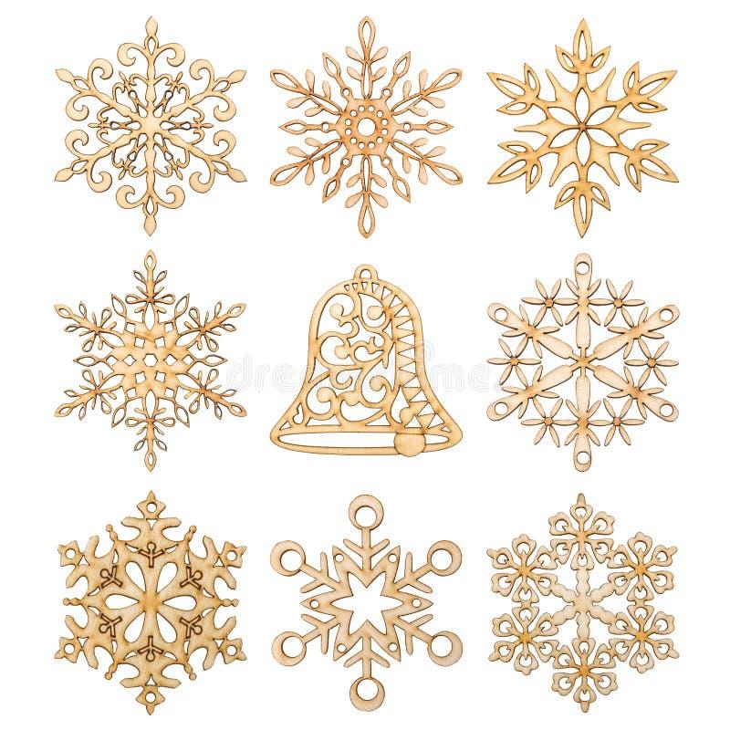 Set Bożenarodzeniowi płatki śniegu i ręka dzwonkowego kształta dekoracja zrobił drewnu royalty ilustracja