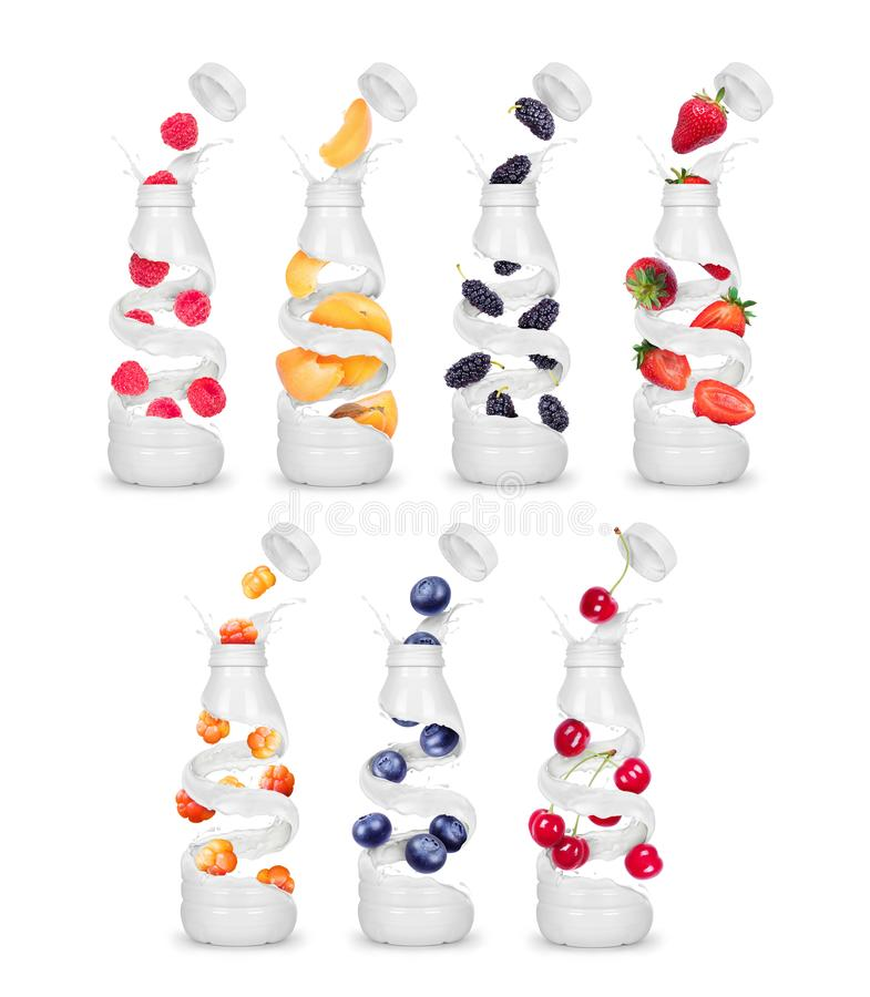 Set of bottles made from milk with various berries stock photo