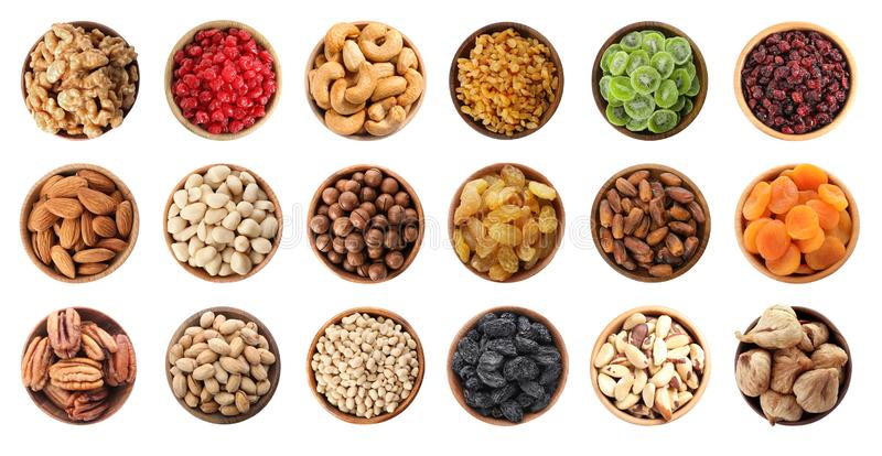 Set of bowls with healthy dried fruits and tasty nuts on white background. Flat lay royalty free stock photos