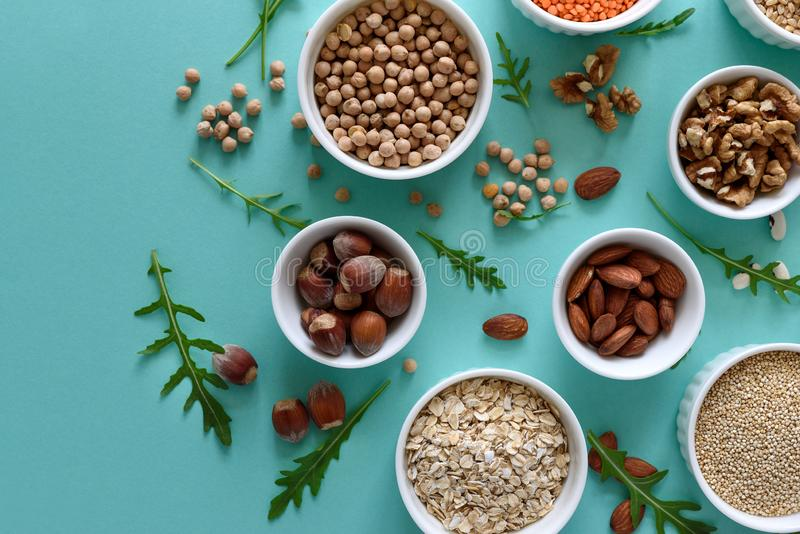 Set of bowls with organic quinoa, lentil, chickpea, wheat, walnut, almond, hazelnut and sesame. Cereals and legumes assortment on royalty free stock photo
