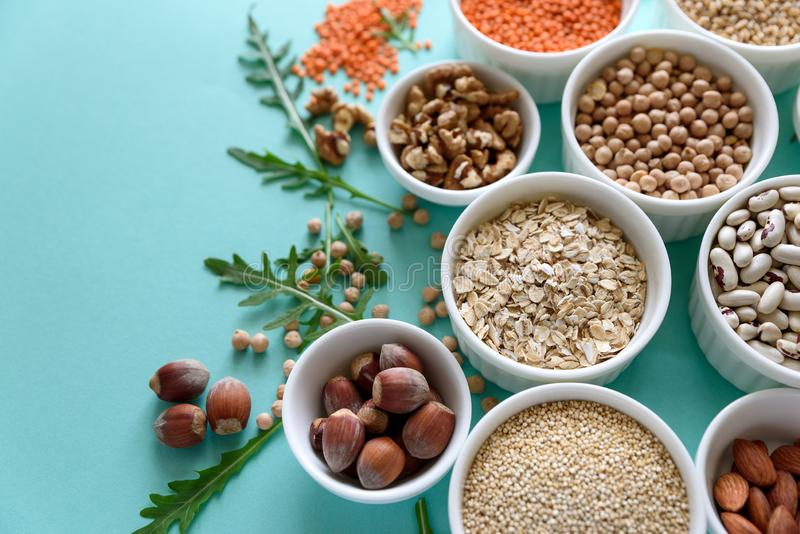Set of bowls with organic quinoa, lentil, chickpea, wheat, walnut, almond, hazelnut and sesame. Cereals and legumes assortment on stock photography