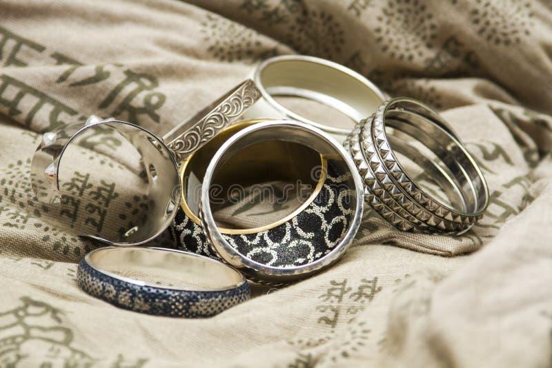 Set of bracelets on a design pillow royalty free stock image