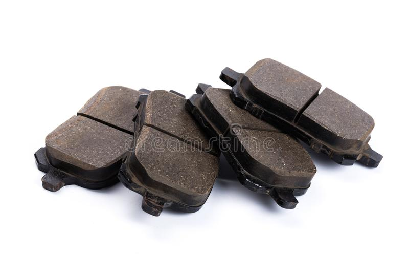 Set of brake pads, car spares isolated on white background stock photos