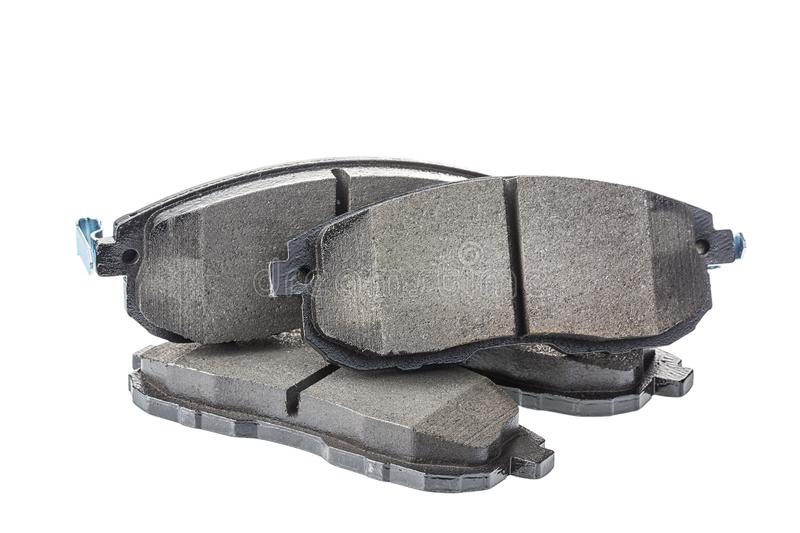 Set of brake pads, car spares isolated on white royalty free stock photography