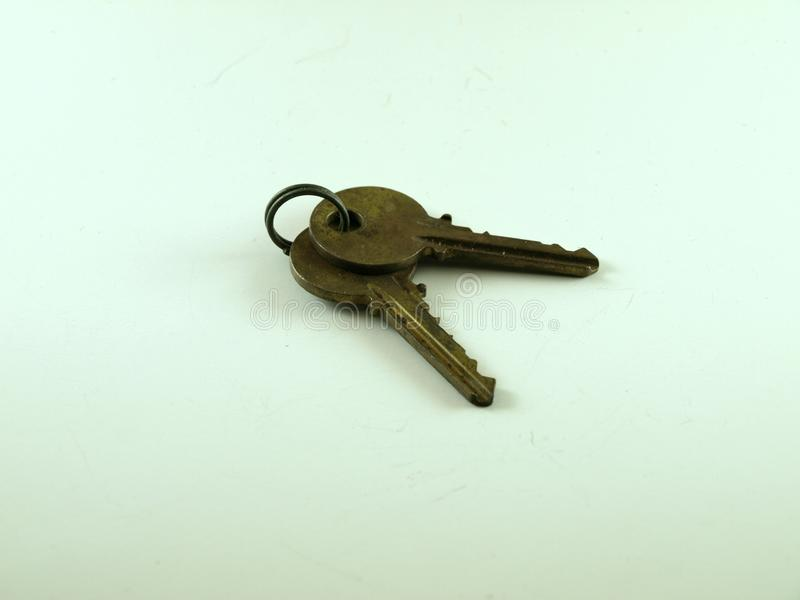 A Set of Brass Keys on a Small Silver Key Ring royalty free stock images