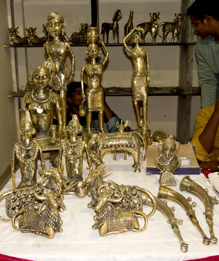 Ancient Indian Style Sculptures or statues of Brass. Set of brass metal sculptures created by tribal people of central India. In which it displayed their daily royalty free stock photography