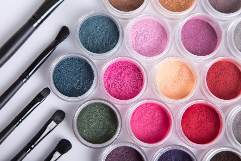 Set of bright mineral eye shadows and brushes. Top view royalty free stock image