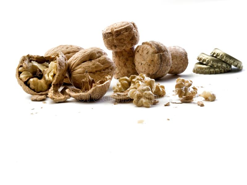 Set of broken nuts, champagne corks and round metal sheets for bottle closure. Set of broken nuts, champagne corks and round metal sheets closing bottles on a royalty free stock image