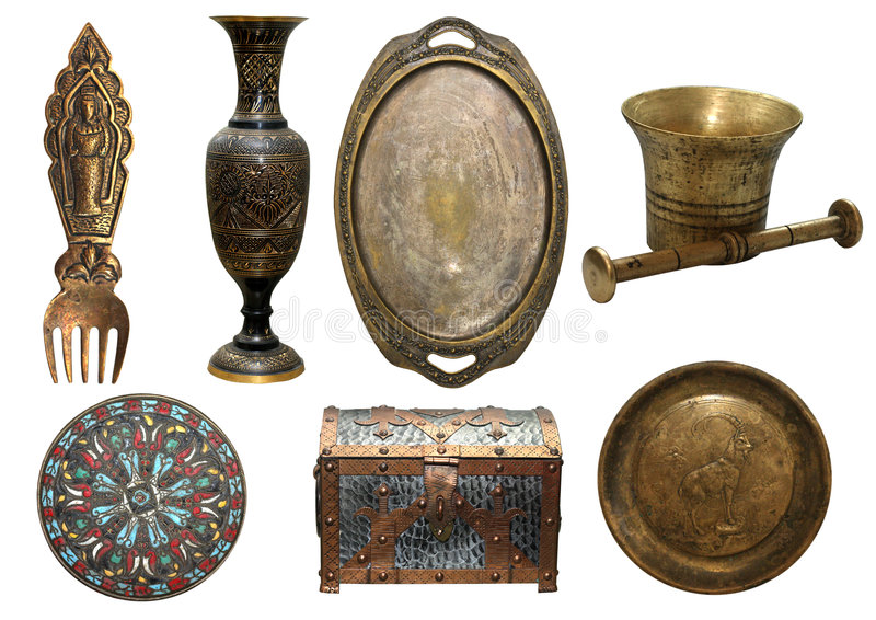 Set of bronze antique items. Vase; trey; fork; plate; cofferet; pounder royalty free stock photos