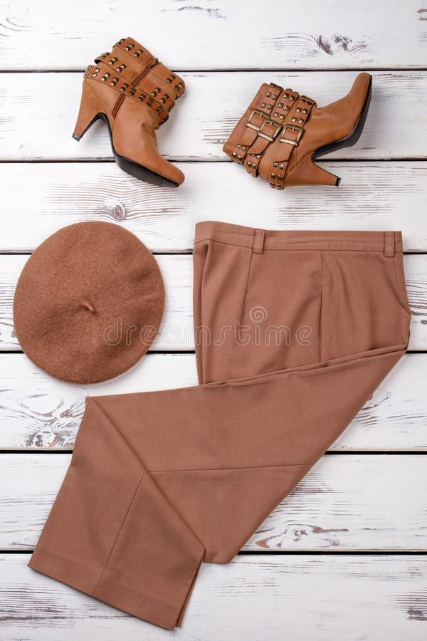 Set of brown colored women clothes. stock images