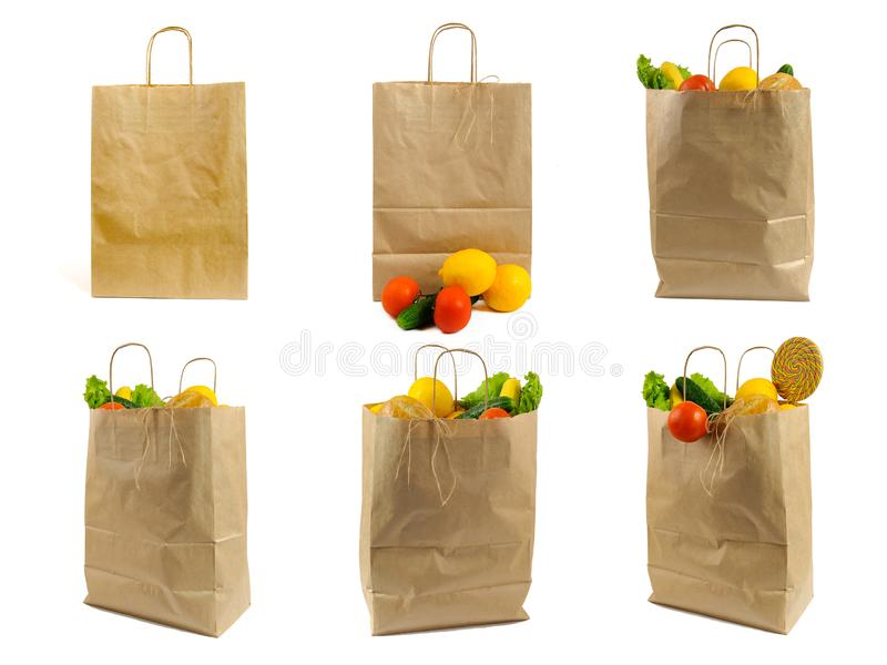 Set of Brown paper bag with vegetables. Recycled pack with fresh organic food isolated on white background stock photo