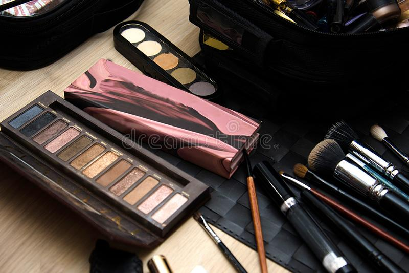 A set of brushes and eye shadows for face makeup royalty free stock photos