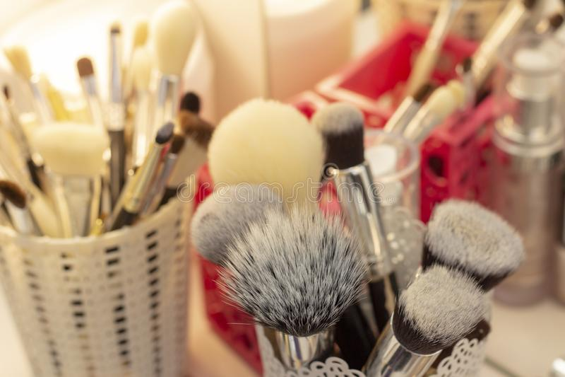 Set of brushes in a glass for applying makeup. tools and fixtures makeup artist stock photography