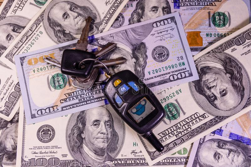 Set of the car keys on a one hundred dollar bills. Set of the car keys on one hundred dollar bills stock photography