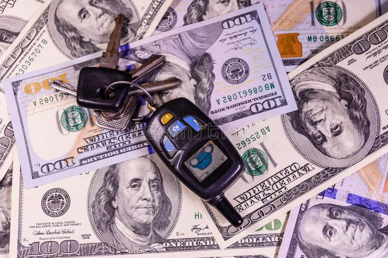 Set of the car keys on a one hundred dollar bills. Set of the car keys on one hundred dollar bills royalty free stock image