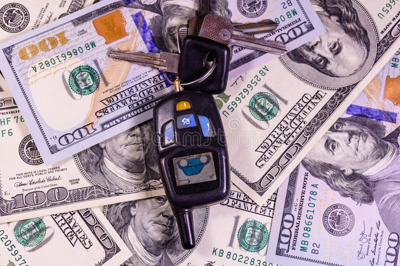 Set of the car keys on a one hundred dollar bills. Set of the car keys on one hundred dollar bills royalty free stock images