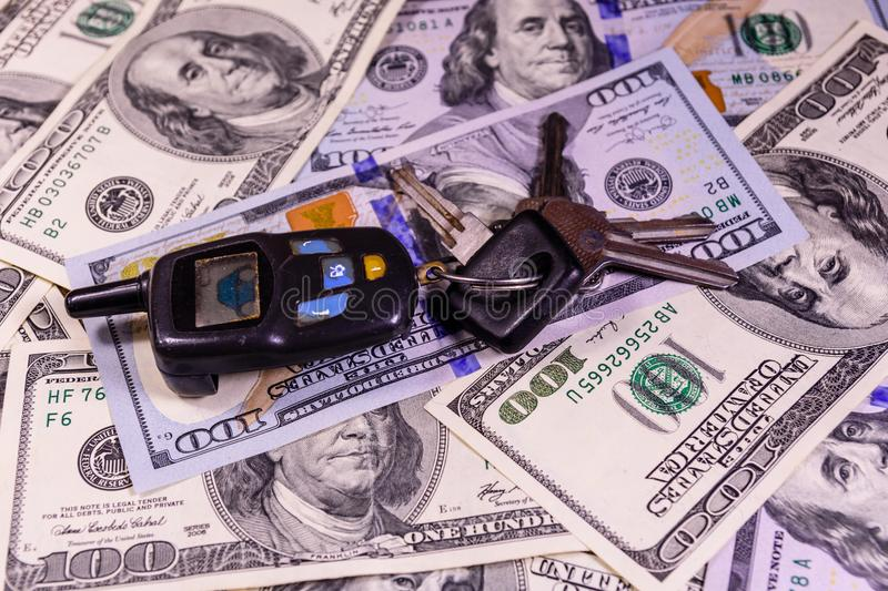 Set of the car keys on a one hundred dollar bills. Set of the car keys on one hundred dollar bills stock images