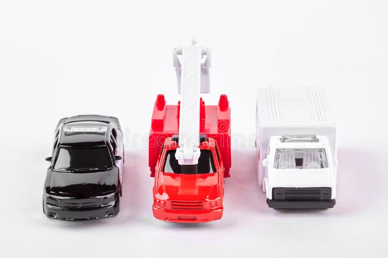 Set of car toys, front view. Police car, fire truck and emergency ambulance car toys on white background royalty free stock images