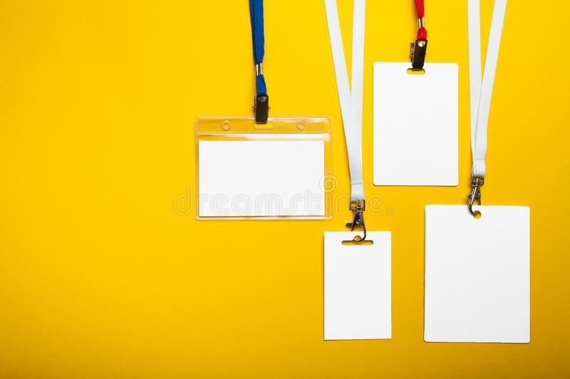 Set of card badges with ropes on yellow background. Mock-up.  stock photo