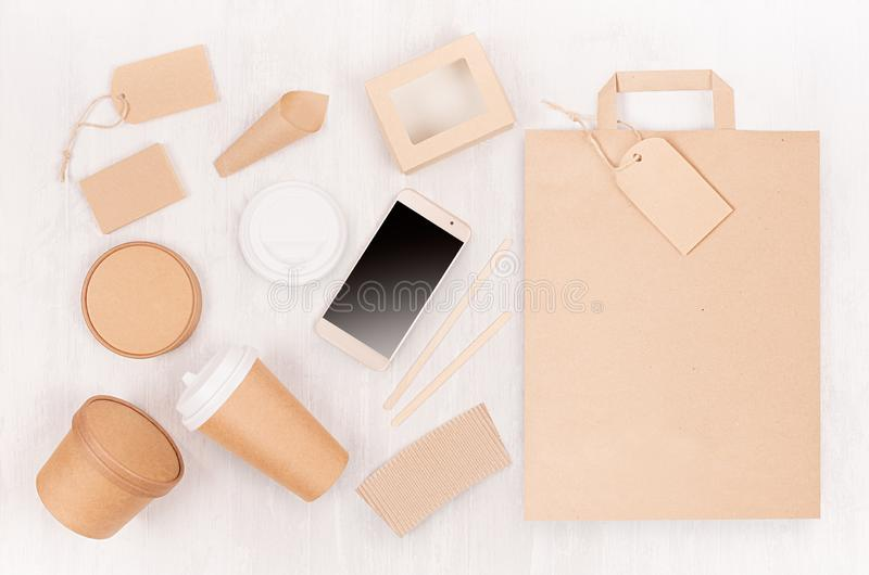 Set of cardboard package for different fast food for advertising, menu, banding identity - blank phone, bag, card, label, cup, box. Packet on white wooden royalty free stock photos