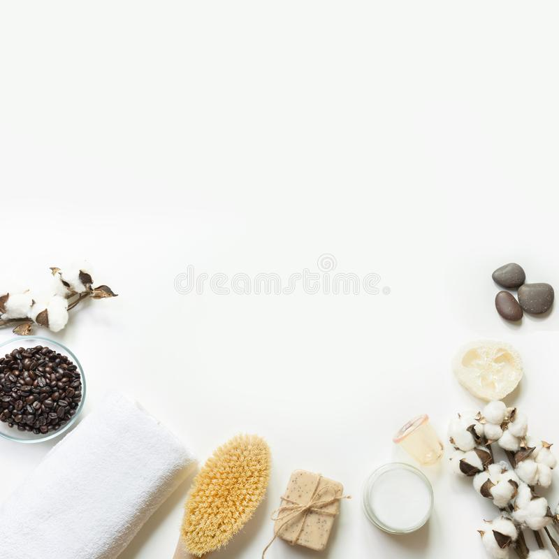 Set for cellulite removal, coffee beans, coconut oil, cotton, vacuum jar on white background. Copy space. Spa concept royalty free stock photography