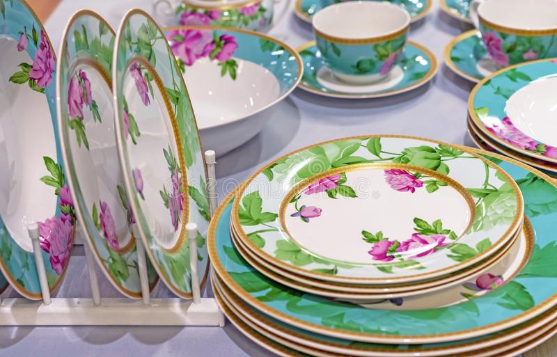 Set of ceramic ware with a flower ornament royalty free stock photo