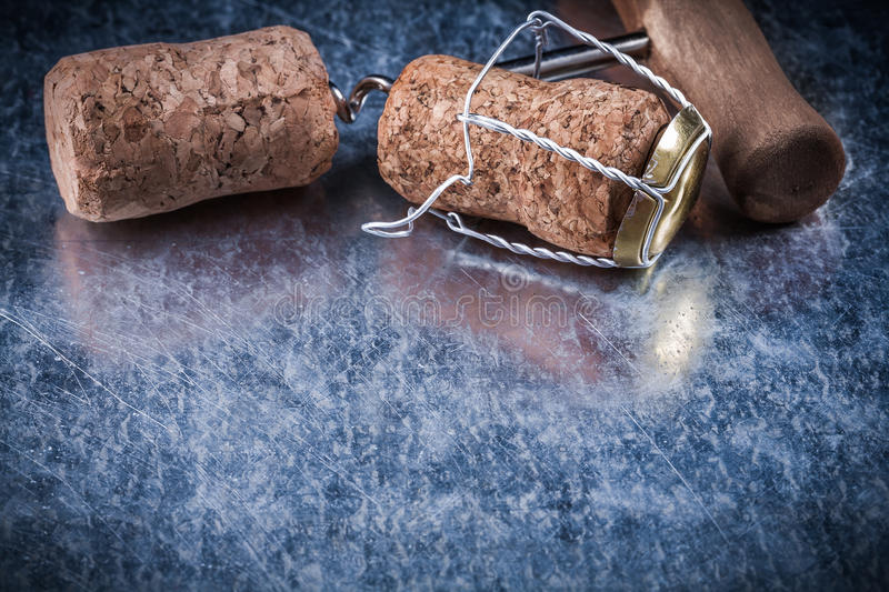 Set of champagne corks twisted wire corkscrew on metallic backgr. Ound stock images