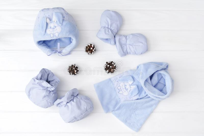 Set of children`s winteror autumn clothes. scarf, hat, mittens and bootd on white background royalty free stock image