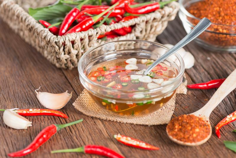 Set of Chili sliced and garlic sliced with fish sauce, Thai style sauce. royalty free stock photography