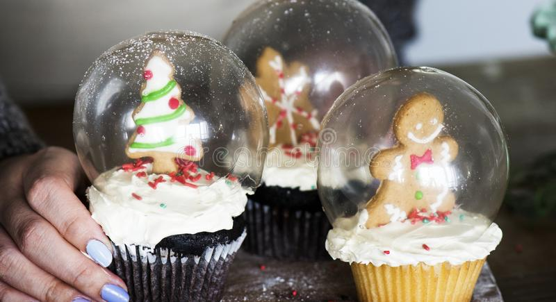Set of Christmas cupcake snow globes stock images