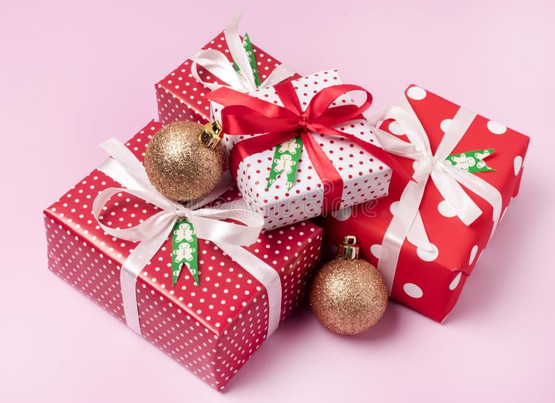 Set of Christmas Gift Boxes Christmas Background Holiday Decorations Presents in a Red Wrapper Pink Background royalty free stock image