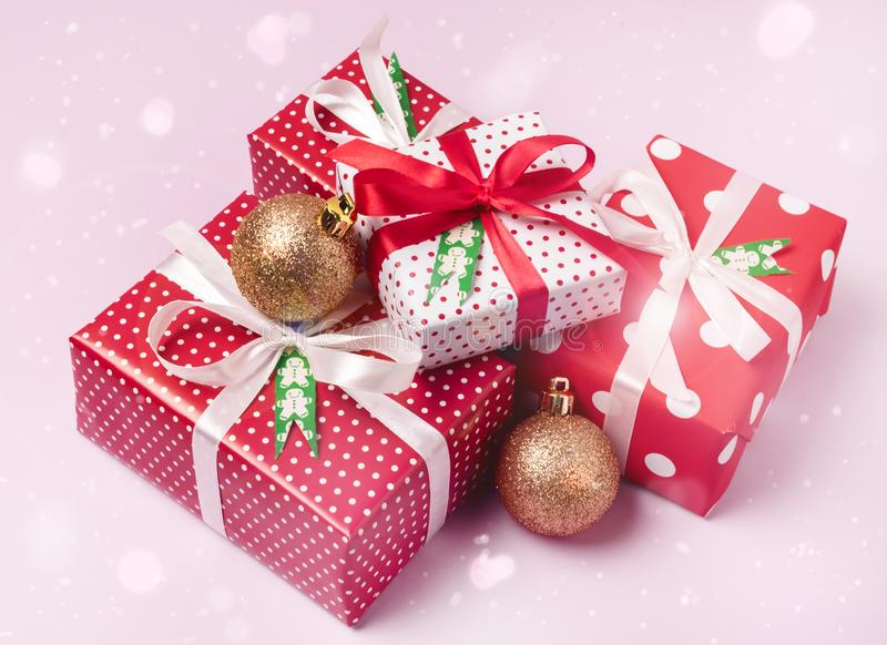 Set of Christmas Gift Boxes Christmas Background Holiday Decorations Presents in a Red Wrapper Pink Background.  royalty free stock photo