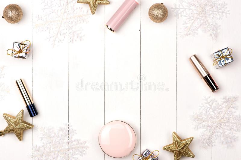 Set of Christmas make up cosmetics products. Flat lay. royalty free stock image